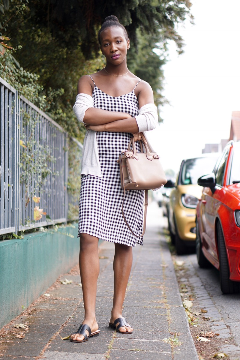 Jey in checkered midi dress