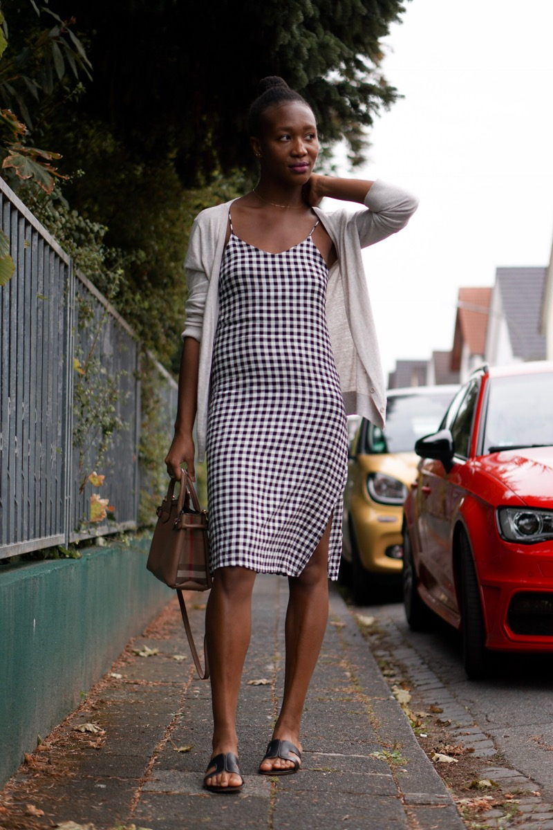 Jey in checkered midi dress
